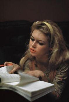 Brigitte Bardot, photographed by Burt Glinn studying a script in Saint-Tropez, France (1958)
