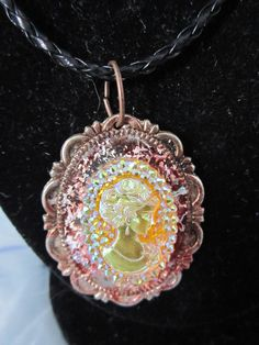 17 Gold toned cameo on chain. $10.00