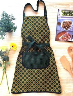 In our home, the kitchen is the center of the house. Everyone spends time in the kitchen while mom cooks. This inspired us these create beautiful aprons made with original shweshwe - a natural cotton that is dyed using a process that has been around for o Green Apron, Pinafore Apron, Kitchen Aprons, Long Ties, African Fabric, Beautiful Patterns, Trending Outfits, Cotton, Clothes