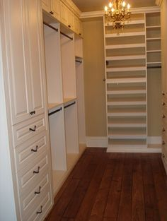 column on drawers and cabinets, divided hanging spaces, long hanging space shoe rack to the ceiling... Perfect closet!