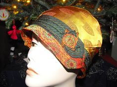Vintage necktie cloche.  Note how the milliner retained the original edges of the ties.