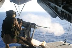 Blast A Marine with Marine Haevy Helicopter Squadron 363, shoots a 50 caliber machine gun from the back ramp of a CH-53D.