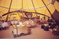Reshaping the way you think about a Tipi! This 3 Tipi set up is perfect for those gatherings who want a little of everything. Dinner seating lounge fire pit & a stage all in one!!  | via lovestruckweddings UK