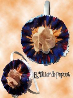 diadema adornada con flor de colores