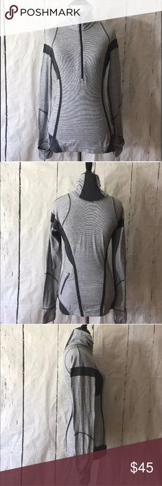 Lululemon U-Turn Half-Zip Micro-Striped Pullover Lululemon U-Turn pullover, missing Size dot and tag (please refer to measurements). Pullover has a high collar, great for cold nights. Sleeve has thumbholes with reversible mittens. Great for the gym, or running. Excellent used condition. Please feel free to ask questions or request pictures. Thanks for looking.   Measurements approx: Armpit to armpit 18 1/2 inches Collar to hem 28 inches Shoulder to sleeve 30 inches lululemon athletica Tops
