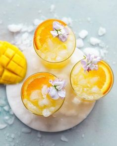 This summer, here are a few of the Instagrammable iced drinks we'll be sipping on. #hunkerhome #summerdrinks #summerdrinkideas #summerdrinkrecipes Tomato Tart Puff Pastry, Tomato Tart Recipe, Puff Pastry Recipes, Tart Recipes, Mango Drinks, Summer Drink Recipes, Fruit Punch, Punch Recipes, Butter Crust