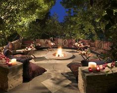 Pillows and candles around fire ring