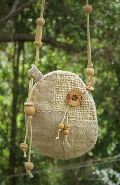 A beautiful patchwork talisman pouch, made using hand woven hemp, indian cotton and natural linen. It has hand stitched details around the edge and the button and beads are made from coconut and wood. All natural materials :) Approximate size of the pouch is 11cm high, by 9cm wide.