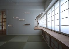 Small Japanese apartment remodelled with curved and letterbox-shaped openings.