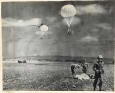 1945- Parapacks of mail being dropped by a transport plane to U.S. Marines on Iwo Jima.