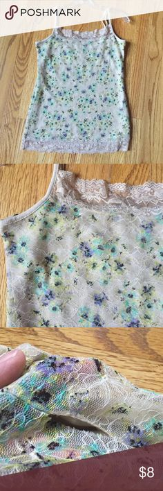 Floral camisole. This elegant floral camisole is perfect to wear under your favorite cardigan or alone. Beautiful floral print with lace accent at collar. Slight hole where seams have come apart at the side, but nothing a little needle and thread can't fix. Adjustable straps. Barely worn and in good condition. Maurices Tops Camisoles