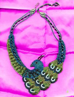 Peacock Bead Embroidered Necklace. €250,00, via Etsy.