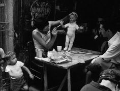 Herbert List View profile ITALY. Naples. 1960. Dolls' doctor. (look at the child's face!!)
