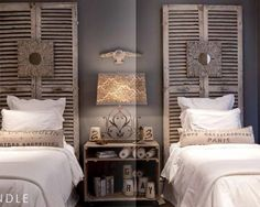 Shutters as a headboard.  I especially like hanging some type of art in the center.  From modvintagelife.blogspot
