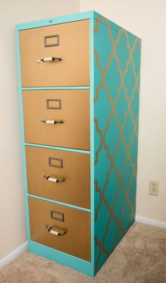 "Metal filing cabinet DIY makeover using Devine Color ""Devine Karat"" gold and printed peel and stick pattern. Replaced handles with antique bronze/ivory style and painted tag holders and drawer latches antique bronze to match."