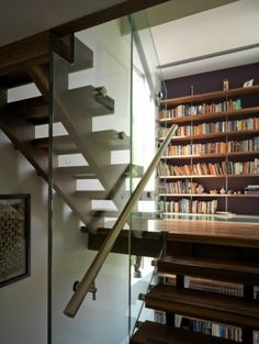 Placing a library space on a slightly oversized landing is a great, cost-effective use of space, and the glass floor in front of the bookcase is a great way to extend the light to below.