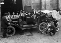 Boys surrounding a Model T Ford while at an engineering class at Wanganui…