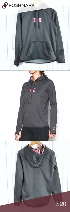 Under Armour Logo Camo Hoodie Sweater Size M In excellent condition under armour hoodie sweater size medium. Relaxed fit. Kangaroo pocket. Warm sweater lined with fleece. Gray lined with pink camo print. Breast cancer awareness ribbon embroidered detail on sleeve. From smoke-free/pet-free home.  Bundle & Save! Offers are welcomed. Under Armour Tops Sweatshirts & Hoodies