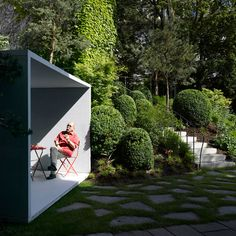 Smoking Room by Gianni Botsford Architects is a translucent-concrete garden folly
