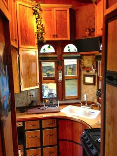 Corner sink in tiny house - 99 sterling house truck has many kitchen cabinets - Image © Michael Ostaski
