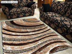 Alfombra Karian 8635 Sualsa, alfombra suave de pelo medio con un elegantísimo y moderno diseño a base de bandas onduladas y semi-circulares, en el que destacan las diferentes alturas y grosores de pelo utilizados.