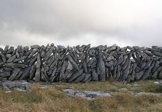 Stone wall in The Burren in NW County Clare, Ireland.-I was told they leave air vents so strong winds don't blow down fences, it passes through.