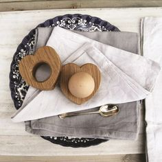 A pair of heart-shaped oak egg cups - LOVE.