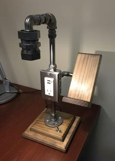 Cool pipe lamp with cell phone holder and USB charging outlet.