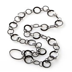 Round, and round, and round she goes – from chasing the kids to chasing the next big client – always keeping those specs front and center. A delicate mix of sizes and metals, these circles come together in an eyewear necklace that works with any outfit – glasses optional!