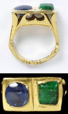 Gold ring, the high pierced rectangular bezel set with a sapphire and an emerald, Roman, 3rd century