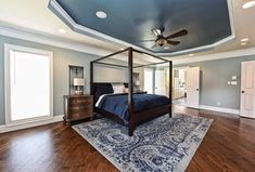 Traditional Master Bedroom with High ceiling, Ceiling fan, Carpet, flush light, Farmhouse Canopy Bed, Crown molding