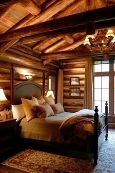 Log cabin idea guest room? It's cozy...Chandler over pool table, wall sconces, throw blanket
