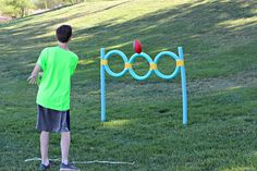 Pool Noodle Ball Toss- Need: 5 pool noodles, duct tape, ball, & rebar from hardware store. Form 3 noodles into rings & tape where they meet. Tape each ring individually, then tape together. Tape end rings to posts. Push the 2 rebar in ground to slide noodles over for posts. Cost-$9