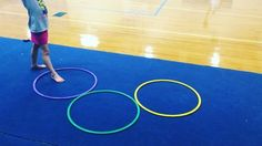 "Having trouble teaching a cartwheel? Make it fun and do ""Mickey Mouse"" cartwheels! Slowly put the hoops in a straight line to make the cartwheel longer!"