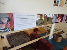 Using a series of enlarged, high-quality photographs that communicate a strong image of children and illustrate the prominent experiences children are having in the classroom. This style of display speaks to both children and adults as the audience.