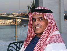 Sheikh Saud bin Saqr Al Qasimi sitting on a veranda.