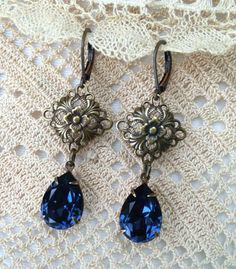 Elegant earrings featuring Vintage Swarovski Sapphire Crystal Pears and Square Antiqued Brass Filigree connectors.  Tilliegirlstudio