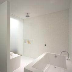 Modern Bathroom with tub in shower area...  Best of all... NO shower doors to clean...
