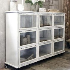 White patinated cabinet in metal