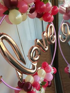 "Gorgeous organic bubbly hoop - adorned with warm ombré tones. of balloons, flowers and finished with Northstar ""Love"" script balloon. Created for our window display but perfect for an engagement or wedding decor"