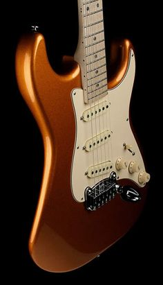 WANT. Designed by Leo Fender. A superior strat, at half the price. And I even like the colour...