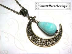 "This necklace was handcrafted by me.  I used a bronze filigree crescent moon charm and added a bronze spacer bead and a beautiful tear drop natural amazonite bead. The pendant hangs almost 2.5"" and comes on your size of bronze link chain."
