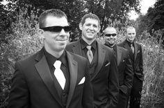 Groom And Groomsmen. Black slacks, jacket and dress shirt. Charcoal grey vest and purple or teal tie.