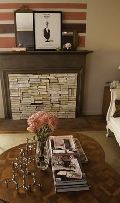 Custom fireplace screen Shannon Kaye made with cross cut books for a twist on 'book 'burning' Fireplace Bookcase, Shiplap Fireplace, Fireplace Mirror, Small Fireplace, Concrete Fireplace, Fireplace Hearth, Marble Fireplaces, Fireplace Cover, Fireplace Filler