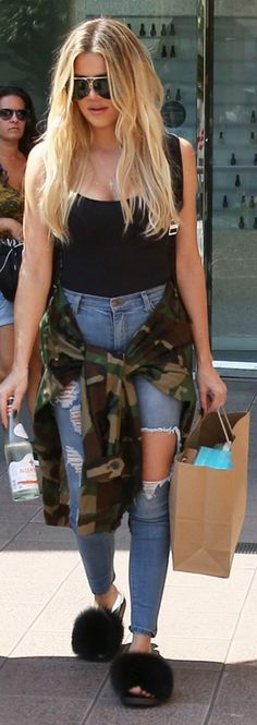 Khloe Kardashian: Shirt – Wolford  Shoes – Givenchy  Jeams – Fashion Nova  Sunglasses – Porsche Design
