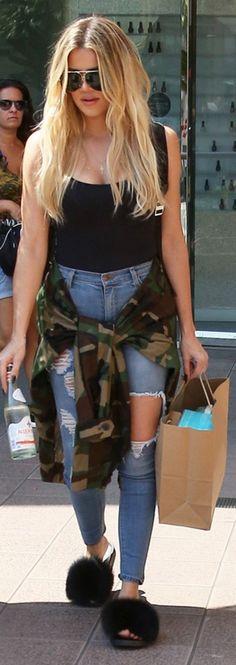 Khloe Kardashian: Shirt – Wolford  Shoes – Givenchy  Jeams – Fashion Nova  Sunglasses – Porsche Design