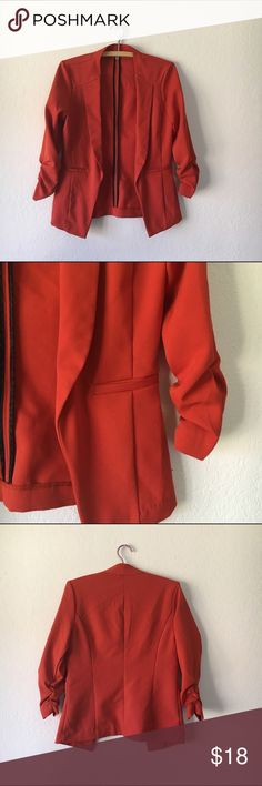 Burnt orange stretchy blazer Easily dress up an outfit or add a pop of color with this blazer. Extremely comfy because it provides some stretch. Size small. Jackets & Coats Blazers