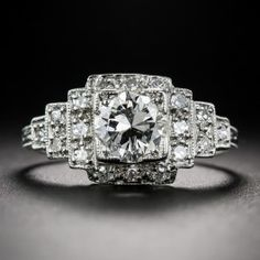.98 Carat Diamond and Platinum Art Deco Engagement Ring - Architecturally-inspired Art Deco engagement ring, circa 1930s, European/round brilliant-cut diamond weighing .98 carats crowns a ziggurat style, platinum mounting with small single-cut diamonds and delicate millegraining.  Lang Antiques  (=)