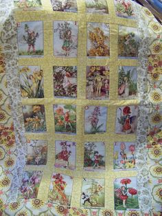patchwork style baby quilt done in flower fairy pattern.