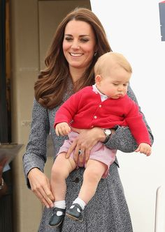 Duchess Catherine and Prince George about to board the plane for Sydney to head home to England
